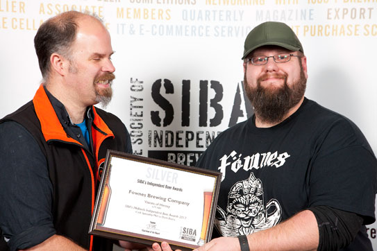 James receiving certificate for Visions of Heresy in cask 2017