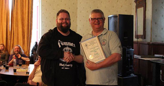 James receiving CAMRA gold award for King Korvak's Saga 2017